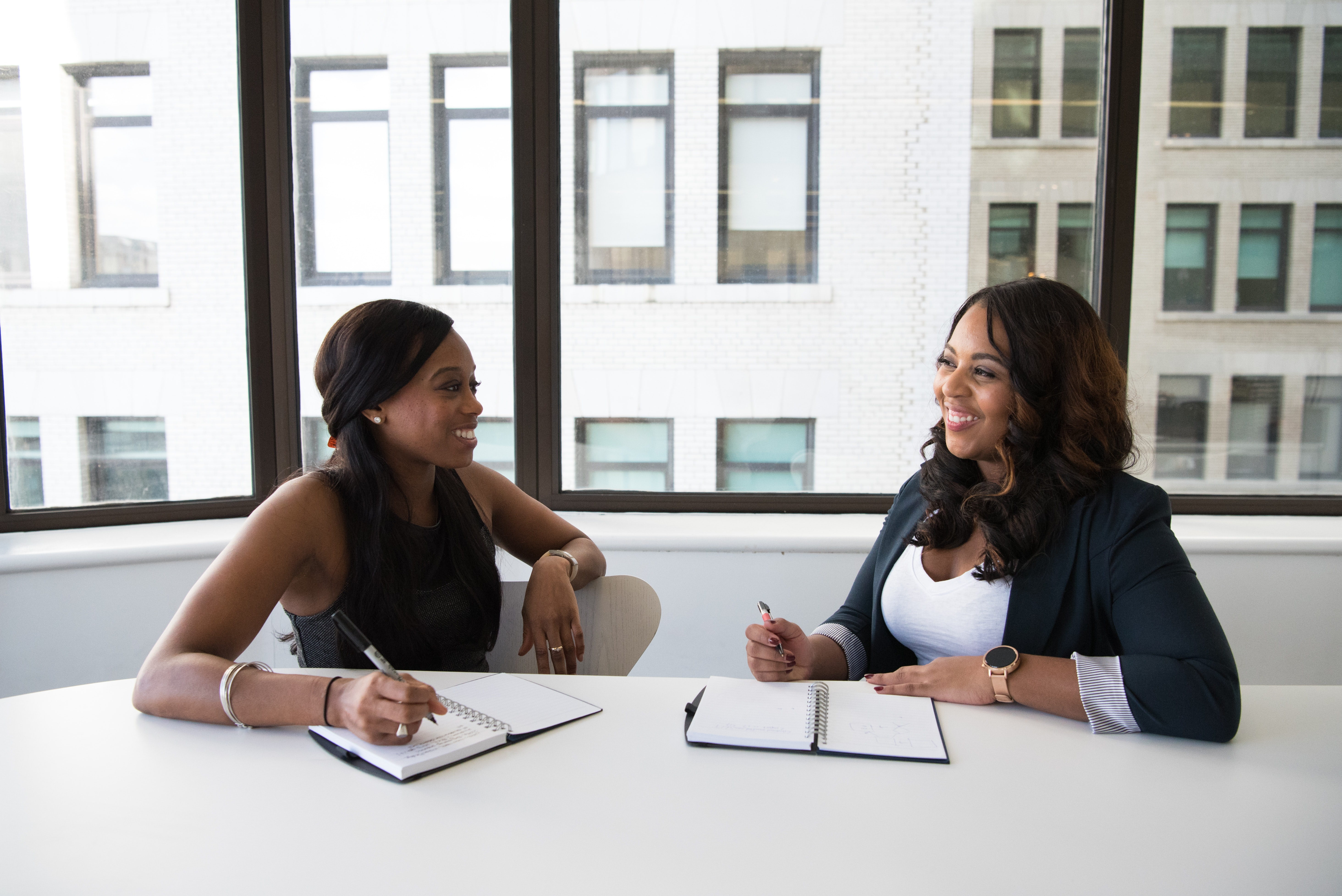 Two ladies in an office setting