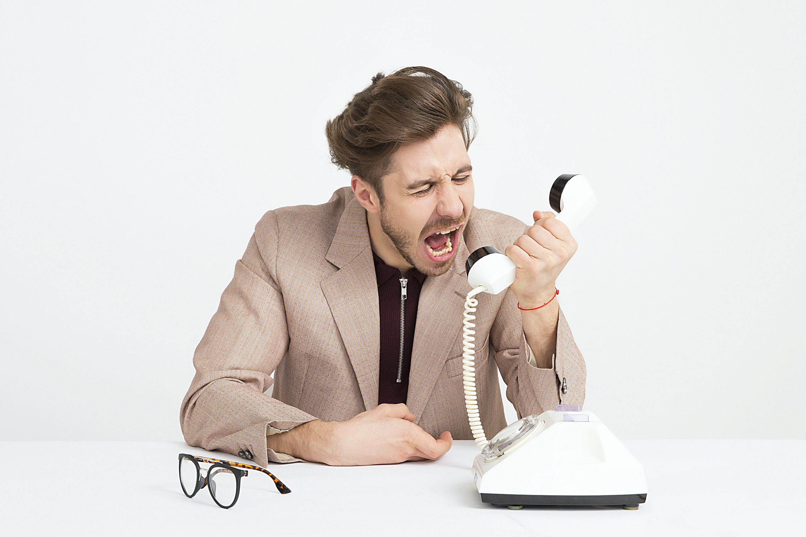 man shouting into the phone