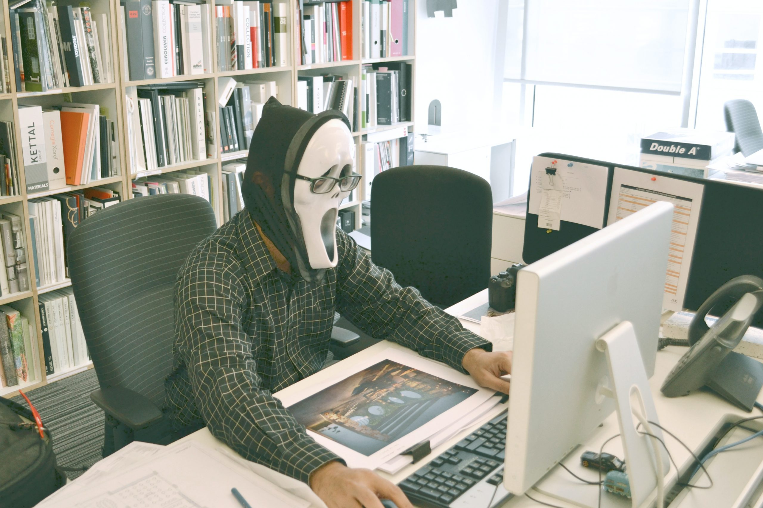 person wearing white mask looking at computer